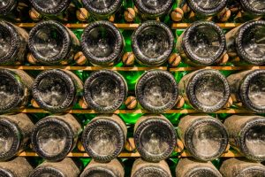 Aging champagne bottles in cellar