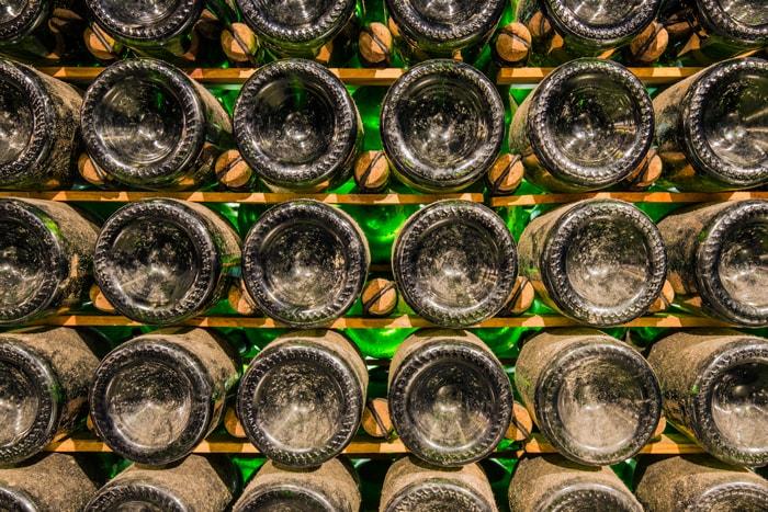 Aging champagne bottles in cellar